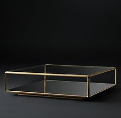RH Modern's Troy Square Coffee Table:Deceptively simple, our table's glass planes and gleaming metal frame capture the bold, futuristic forms of the 1970s. Designed by the Van Thiels, it has a low inset foot that creates an illusion of weightlessness, while intricate chamfered edges reflect timeless craftsmanship.