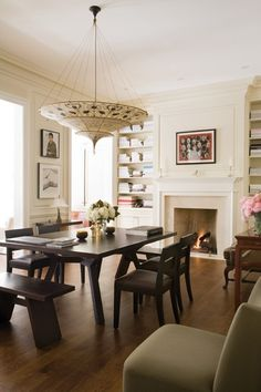 Fortuny pendant + built-ins + fireplace + modern eclectic dining design via Paul Sinclaire