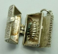 1960s English silver charm of a rolled up carpet that opens to reveal a carpet bug inside, SUPER charm that is hard to find - 45gbp