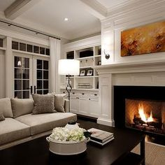 Paul Moon Design - living rooms - gray, sofa, taupe, pillows, French doors, transom, windows, white, built-ins, cabinets, shelves, fireplace, orange, red, abstract, art, black, sconces, black, Arteriors, floor lamp, espresso, rectangular, coffee table, sisal rug,