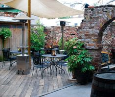 America's best outdoor bars: Blind Tiger, Charleston...again love the sail cloth look appears to be a natural canvas... the worn brick is amazing too!!