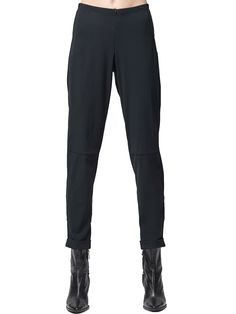 A pair of slim, high rise pants for business or travel. Seam style lines create subtle interest. Hidden elastic waist creates a fitted look with stretch. Invisible front zipper allows easy dressing. Zipper at ankle stays hidden in the turned-up cuff. Made in the U.S.A. High Rise Pants, Cuffed Pants, Simple Dresses, Elastic Waist, Dressing, Sweatpants, Pairs, Slim, Zipper