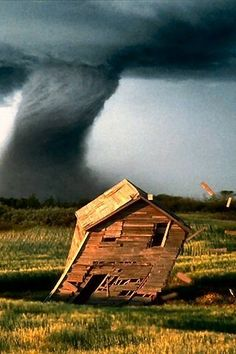 There was a house, half-twisted by a tornado, that stood for at least ten years of my childhood next to the highway. We would watch it carefully every time we passed and make bets on when it would finally topple. I think it eventually had to be taken down by the county.                                                                                                                                                      More