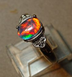 14K solid White Gold Opal & Diamond ring.Engagement opal ring. Genuine Opal Australian Natural opal triplet.Antique style.Diamonds by AmyKJewels on Etsy https://www.etsy.com/listing/223981536/14k-solid-white-gold-opal-diamond