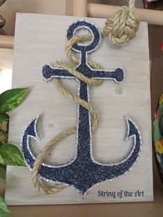 String Art Kit, DIY Crafts Kit, Anchor String Art. This beautiful Kit comes with all the highest quality embroidery floss, metalicc wire nails, instructions, a HAND sanded and HAND stained whitewashed wood board, and a pre-tied monkey fist knotted rope! Visit www.StringoftheArt.com to learn more. Anchor String Art, Nautical Decor, Anchor Decor, Home Decor, Crafts Project, Crafts Idea, Nautical Idea #Crafts