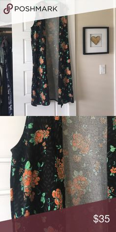 Lularoe worn once, but in great condition! Super cute pattern, just a little big for me. Spent $65, but asking 35... open to reasonable offers as well! LuLaRoe Other