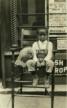 Vintage photograph of a little boy and his poodle <3