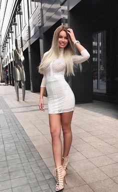 I ❤️ her tight mini dress and high heels, she has beautiful long legs
