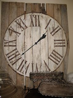 Take apart a pallet, then put all the boards together and nail them. Then use a pattern for the circle, fill it in with some cream paint. Then use a little stain over the cream to give it a vintage look. Print out roman numerals from the computer using word, cut them out and trace them on to the clock face and paint them in with a brown paint. Buy the clock hands and install.