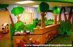 Themed Children's Church Sign In Desk   Features: Woodland Animal Murals Surrounded By 3-D Props and Scenery with Bible Story Hallway.