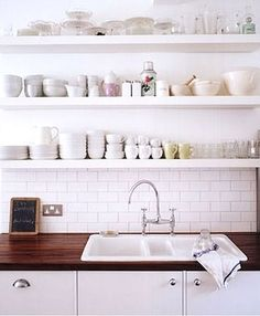 : floating shelves in the kitchen Love the bright white with wood countertops. The floating shelves are the perfect touch to this kitchen.Love the bright white with wood countertops. The floating shelves are the perfect touch to this kitchen. Kitchen Ikea, Kitchen Shelves, Kitchen Dining, Kitchen Decor, Kitchen Cabinets, White Cabinets, Kitchen White, Kitchen Sink, Kitchen Wood