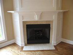 Corner fireplace..more economical surround?