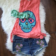 UO Side-tie muscle tee Bright coral sugar skull muscle tee with deep armholes for flashing a cute sports bra during your daily jog, a bandeau during a music festival, or that sexy bikini top at the beach  Worn once and washed - great condition! Urban Outfitters Tops Muscle Tees