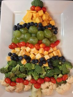 Santa veggie tray. Cucumber slice face, red pepper hat, nose and ...