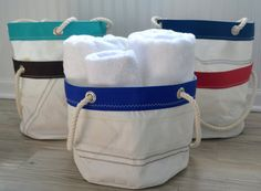 Beautifully constructed carry all totes are made entirely of recycled sail cloth! Truly endless uses for this unique bucket tote. Let us know how you use yours. Find this Etsy listing at https://www.etsy.com/listing/223783368/sail-anew-bucket-totes