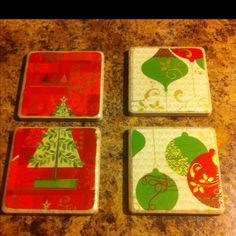 Cute Christmas coasters made out of tile, wrapping paper, and mod podge