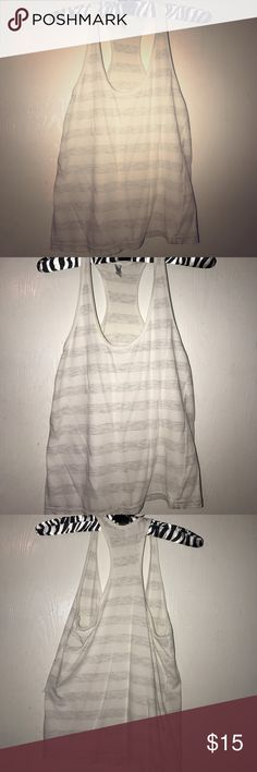 American Apparel stripped racer back tank Tiny hole pictured. White and heathered grey stripes racer back or muscle tee. American Apparel Tops Tank Tops