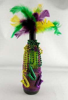 DIY Beaded Mardi Gras Wine Bottle Decoration with Fairy Lights! http://www.lightsforalloccasions.com/p-4534-4-amazing-diy-mardi-gras-decorations.aspx