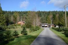 HOME ON 25 ACREAGES 12338 Hwy 101 Powell River BC 2 properties - 2 separate titles, sold together. 1st property is level south facing 12.95 acres, 2300 sq. ft. home with 2 bdrms, large rec , oak kitchen, covered front deck & rear patio. Double garage with workshop, storage shed, private gardens & beautiful large pond. 2nd property is 12.5 level acres with great soil, separate septic & water to old modular home site. Operating as a Christmas tree farm, equipment to operate is optional. Powell River, Front Deck, Workshop Storage, Christmas Tree Farm, Double Garage, Private Garden, Sunshine Coast, Vancouver Island, South America