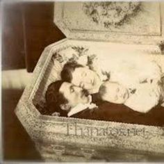 Although I found this strange post mortem photograph on Tumblr, the faint watermark tells me that it is actually from the fabulous Thanatos Archives. I've seen several post mortem photos of siblings in coffins, but I think this is the first time I've found one that shows an entire family.