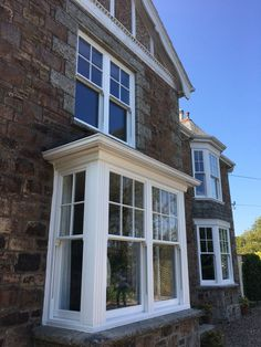 Why is uPVC better than timber for replacement sash windows? Premium uPVC sliding windows offer low-maintenance, whilst maintaining the look of timber. Casement Windows Exterior, French Doors Exterior, Upvc Sash Windows, Bay Window Exterior, Bow Window, Edwardian House, Cottage Windows, House Exterior, Window Design