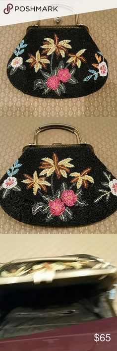 Gorgeous Beaded Bag! Colorful and full of shine, perfect for any fun occasion. This bag is in very good condition and all beads are intact. Snap top closure with metal handles and a long chain strap that can be tucked inside the bag when not needed extra black seed beads included . It's a little brighter in color then what the pictures indicate. Bags