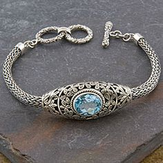 @Overstock - Blue topaz set in a stunningly crafted silver bracelet  Handmade jewelry features floral-inspired designs  Toggle wrist cuff crafted by talented Indonesian artisanshttp://www.overstock.com/Worldstock-Fair-Trade/Sterling-Silver-Cawi-Blue-Topaz-Toggle-Bracelet-Indonesia/3938933/product.html?CID=214117 $124.89