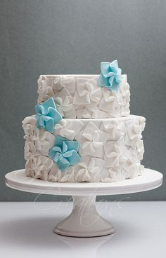 "Something Blue cake by Rouvelee's Creations ""Cluster of 5-petal fantasy flowers adorn this cake. The fantasy flowers were made by cutting out 5 heart shapes and interlocking them with each other."""
