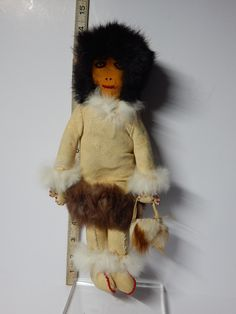 A personal favorite from my Etsy shop https://www.etsy.com/ca/listing/211794758/vintage-inuit-eskimo-doll-with-fur-beads