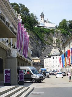go to a Mozart Symphony in Mozart's hometown of Salzburg, Austria; this is the Grosses Festspielhaus concert hall.