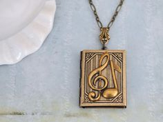 antiqued brass locket necklace, THE G-CLEF, music notes necklace, music lover locket, book locket, gift for musician by plasticouture