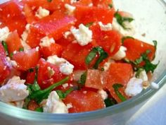 Watermelon and Feta Salad    6-8 cups watermelon, diced (1/2 large melon)    1 cup feta cheese, crumbled    1/4 cup fresh basil, diced    Combine all ingredients in a very large bowl and mix. Refrigerate until cold before serving.  Serves 8.