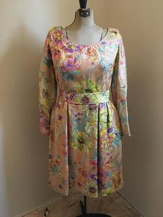 Beautiful Clifton Wilhite formal ware dress. Gorgeous print, shiny fabric. Great for any occasion or the upcoming holiday season!! The item was in storage for about 20 years, I did not fully clean the item due to age and peoples preference to techniques. I did however use a costume spray