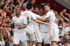 Ki Sung Yueng celebrates with team mates after scoring the third goal for Swansea in the 1-4 win