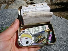 A geocache  [PLUS OODLES of other ideas using Altoid Tins !  found here: http://www.wikihow.com/Reuse-an-Empty-Altoids-Tin  - NB]