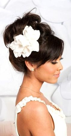 Bride's high looped messy updo with bangs bridal hair Toni Kami Wedding Hairstyles ♥ ❷ Wedding hairstyle ideas Flower accent