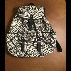 Aeropostale Backpack ! ❤️ Aeropostale black and white Aztec design ! 2 side pockets ! Front magnetic snap compartment ! Inside is black ! Magnetic Snap closure with vegan leather drawstrings ! It's a beauty ! ❤️ Aeropostale Bags Backpacks