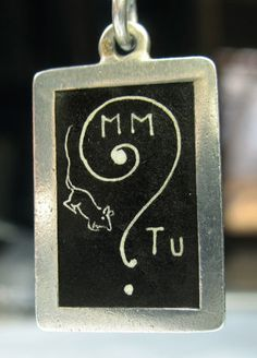 """1900's French rebus chalkboard charm reads, """"M'aimes-tu?"""" which translates to, """"Do you love me?"""""""