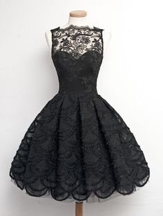love this lacy black dress and how it open at the bottom