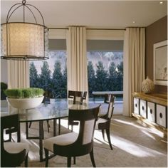 Thomas Pheasant  love that awesome pendant chandelier, and the window treatments.