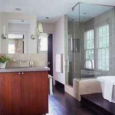 love the bath tub on top a wooden platform