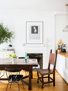 A fresh update for the dining room – mix mismatched chairs with a sturdy farm table as a setting to drink your morning coffee. Hang a newspaper clipping (or favorite mag cover) in a black frame over the mantel, and opt for a muted color-palette. Sip, and repeat.