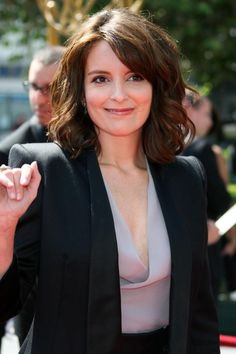 Tina Fey Lookbook: Tina Fey wearing Medium Wavy Cut (9 of 14). Tina's hair is styled down with large sexy waves that look great with her top and bold shouldered blazer.