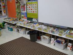 Love this picture from ILteachk1on Flickr, using cinder blocks & white shelving to make a book shelf across the whole wall