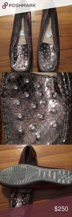 Stuart Weitzman flats Bronze flats with Swarovski crystals!  Perfect to dress up or dress down a look!  Worn once, perfect! Stuart Weitzman Shoes Flats & Loafers
