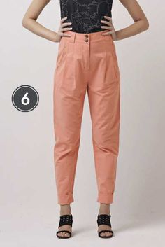 Colored trousers are great choices especially this peach pink colored ones! Very natural and simple.