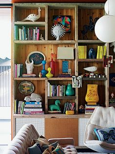 That's my kind of styled book case - eclectic, vintage, modern room design. Photo by Richard Powers