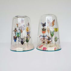 "Lyndie Dourthe - bell jars with ""specimens"""