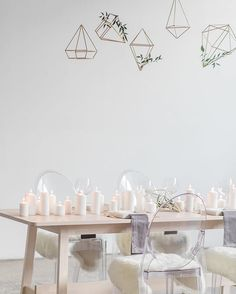 Geometric shapes made of wood, hot glue and spray painted, by A Blush Moment.  Looks like the metal ones but so much more economical!   Credits from the instagram post :   The team: Wedding planning & styling @ablushmoment Photography @rhythmandme Videography @norrisfilms Hair & makeup @muahbeauty Cake @sugartiers Models @orangemodels @melanie_mueller5 @broskar Jewellery @theloved_one Chairs @chairmanmills Suit @wingmensuits Venue @airship37 Gown by Elmwood Brides