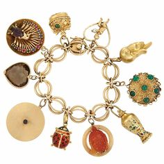 Gold Charm Bracelet  14 kt., 10 charms, ap. 67.6 dwts. Length 7 inches.